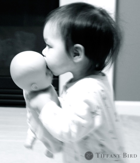 Elle kissing baby.